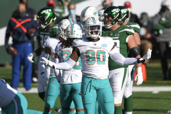 Miami Dolphins' Shaq Lawson reacts during the first half of an NFL football game against the New York Jets, Sunday, Nov. 29, 2020, in East Rutherford, N.J. (AP Photo/Bill Kostroun)