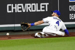 Kansas City Royals left fielder Alex Gordon can't catch a foul ball hit by Detroit Tigers' Victor Reyes during the seventh inning of a baseball game Thursday, Sept. 24, 2020, in Kansas City, Mo. (AP Photo/Charlie Riedel)