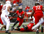 FILE - In this Sept. 15, 2018, file photo, Maryland quarterback Tyrrell Pigrome, center, rushes the ball in the first half of the team's NCAA college football game against Temple in College Park, Md. Maryland first-year coach Mike Locksley will choose among igrome, Max Bortenschlager, Tyler DeSue and Virginia Tech graduate transfer Josh Jackson. (AP Photo/Patrick Semansky, File)