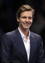 Tomas Berdych of the Czech Republic smiles as he stands on court during a ceremony to honour former tennis players at the ATP World Tour Finals at the O2 Arena in London, Saturday, Nov. 16, 2019. (AP Photo/Kirsty Wigglesworth)