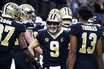 New Orleans Saints quarterback Drew Brees (9) celebrates his touchdown pass to tight end Josh Hill, which broke the NFL record for career touchdown passes, surpassing Peyton Manning, in the second half of an NFL football game against the Indianapolis Colts in New Orleans, Monday, Dec. 16, 2019. (AP Photo/Butch Dill)