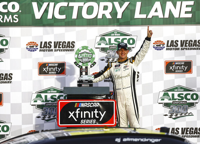 AJ Allmendinger celebrates after winning a NASCAR Xfinity Series auto race at Las Vegas Motor Speedway, Saturday, March 6, 2021. (Chase Stevens/Las Vegas Review-Journal via AP)