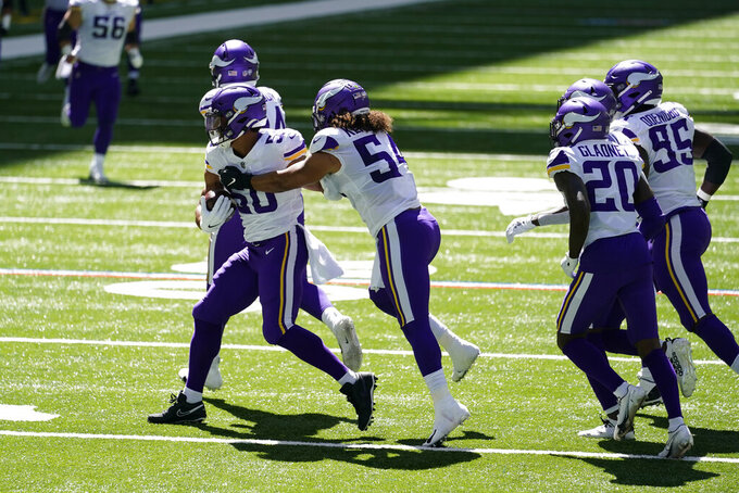 Minnesota Vikings linebacker Eric Wilson (50) celebrates an interception during the first half of an NFL football game against the Indianapolis Colts, Sunday, Sept. 20, 2020, in Indianapolis. (AP Photo/Michael Conroy)