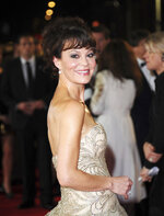 """FILE - Helen McCrory arrives at the world premiere of """"Skyfall"""" in London on Oct. 23, 2012. McCrory, who starred in the television show """"Peaky Blinders"""" and the """"Harry Potter"""" movies, has died. She was 52 and had been suffering from cancer. Her husband, actor Damian Lewis, said Friday that McCrory died """"peacefully at home"""" after a """"heroic battle with cancer."""" (Photo by Stewart Wilson/Invision/AP, File)"""