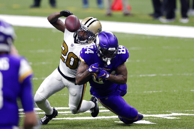 New Orleans Saints cornerback Janoris Jenkins (20) breaks up a pass intended for Minnesota Vikings tight end Irv Smith (84) in the first half of an NFL football game in New Orleans, Friday, Dec. 25, 2020. (AP Photo/Butch Dill)