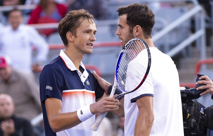 Karen Khachanov, right, of Russia congratulates compatriot Daniil Medvedev for the latter's victory during the Rogers Cup men's tennis tournament semifinals Saturday, Aug. 10, 2019, in Montreal. (Paul Chiasson/The Canadian Press via AP)