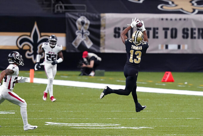 New Orleans Saints wide receiver Michael Thomas (13) pulls in a pass reception in the first half of an NFL football game against the Atlanta Falcons in New Orleans, Sunday, Nov. 22, 2020. During the first half, Thomas moved ahead of Jarvis Landry for the most catches in first five years in the NFL. (AP Photo/Butch Dill)