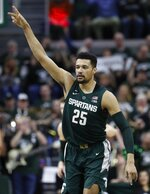 Michigan State forward Kenny Goins reacts after a basket during the first half of an NCAA college basketball game against Nebraska, Tuesday, March 5, 2019, in East Lansing, Mich. (AP Photo/Carlos Osorio)