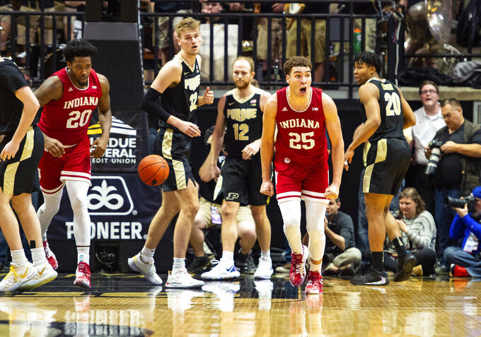Indiana forward Race Thompson (25) reacts after scoring during the second half of an NCAA college basketball game against Purdue, Thursday, Feb. 27, 2020, in West Lafayette, Ind. (AP Photo/Doug McSchooler)