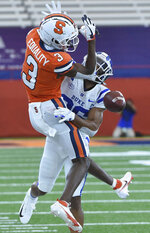 and Duke safety Michael Carter II (26) breaks up a pass intended for Syracuse wide receiver Taj Harris (3) during an NCAA college football game,  Saturday, Oct 10, 2020, at the Carrier Dome in Syracuse, N.Y. (Dennis Nett/The Post-Standard via AP)