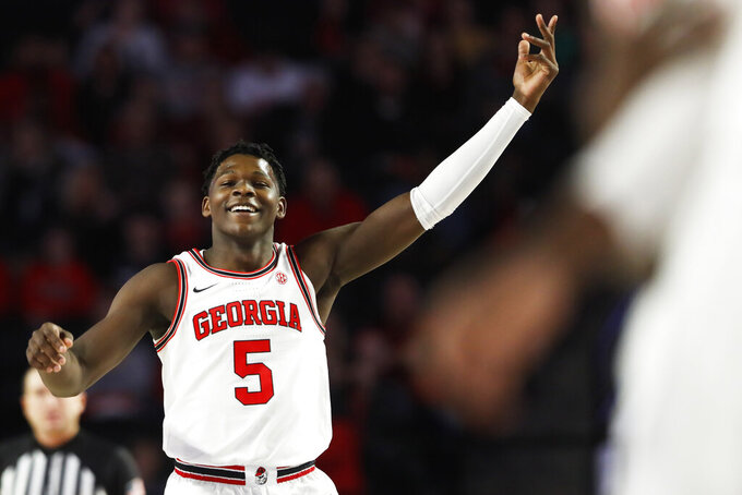 Georgia's Anthony Edwards (5) celebrates after making a 3-pointer against Arkansas during an NCAA college basketball game in Athens, Ga., Saturday, Feb. 29, 2020. (Joshua L. Jones/Athens Banner-Herald via AP)