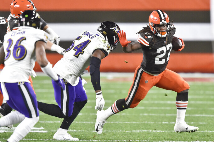 Cleveland Browns running back Kareem Hunt (27) runs after a catch during the first half of an NFL football game against the Baltimore Ravens, Monday, Dec. 14, 2020, in Cleveland. (AP Photo/David Richard)