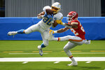 Los Angeles Chargers running back Austin Ekeler makes a catch as Kansas City Chiefs safety Juan Thornhill defends during the first half of an NFL football game Sunday, Sept. 20, 2020, in Inglewood, Calif. (AP Photo/Kyusung Gong)