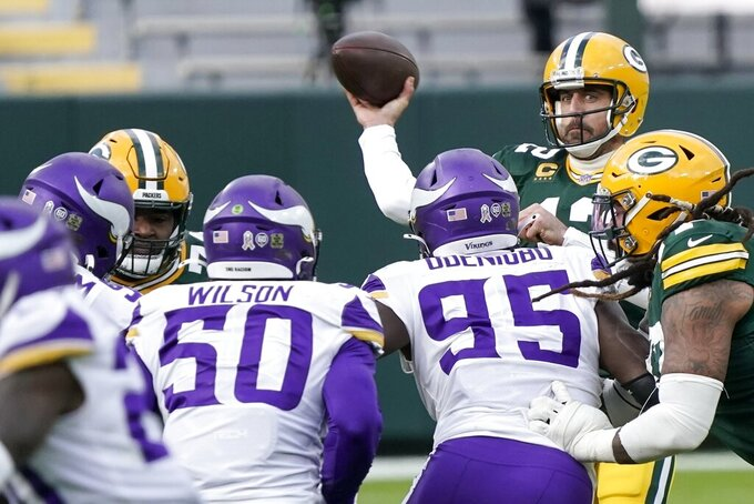 Green Bay Packers' Aaron Rodgers passes during the second half of an NFL football game against the Minnesota Vikings Sunday, Nov. 1, 2020, in Green Bay, Wis. (AP Photo/Morry Gash)