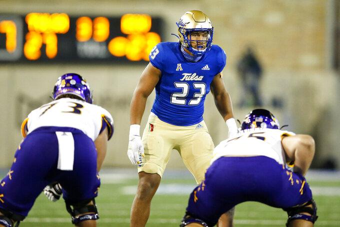 Tulsa Golden Hurricane linebacker Zaven Collins (23) gets into position during a NCAA football game in Tulsa. Okla. on Friday, Oct. 30, 2020.(Ian Maule/Tulsa World via AP)