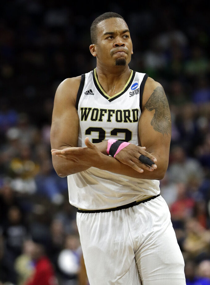 Wofford's Cameron Jackson gestures toward the team's bench after making a basket against Seton Hall during the first half of a first-round game in the NCAA men's college basketball tournament in Jacksonville, Fla., Thursday, March 21, 2019. (AP Photo/John Raoux)