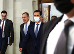 In this photo released by Russian Foreign Ministry Press Service, Russian Foreign Minister Sergey Lavrov, second left, and Syrian President Bashar al-Assad, center, enter a hall for their talks in Damascus, Syria, Monday, Sept. 7, 2020. Russia's foreign minister has met with Syrian President Bashar Assad shortly after landing in the Syrian capital on his first visit since 2012. Russia has been a close ally of Assad in Syria's long and bloody nine-year-long civil war, lending his government in Damascus vital military, economic and political support. (Russian Foreign Ministry Press Service via AP)