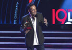 Jorge Drexler accepts the award for song of the year for