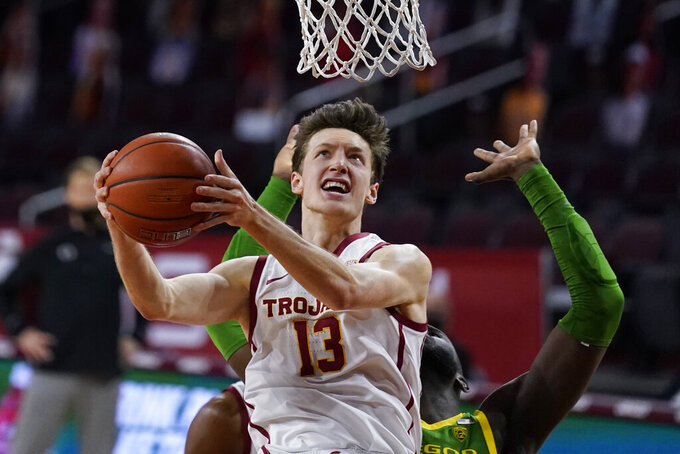 Southern California guard Drew Peterson (13) shoots during the second half of an NCAA college basketball game against Oregon Monday, Feb. 22, 2021, in Los Angeles. (AP Photo/Ashley Landis)