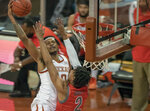Texas forward Gerald Liddell (0) drives to the basket against Texas Rio Grande Valley's Quinton Johnson II (2) during the first half of an NCAA college basketball game, Wednesday, Nov. 25, 2020 in Austin, Texas. (Ricardo B. Brazziell/Austin American-Statesman via AP)