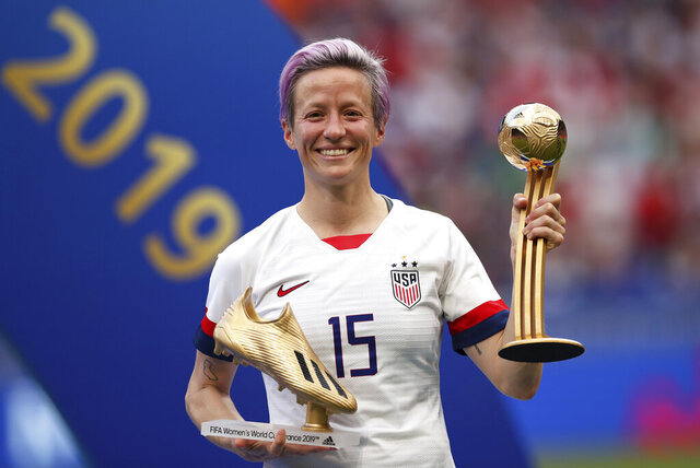 FILE - In this Sunday, July 7, 2019 file photo, United States' Megan Rapinoe poses with her individual awards at the end of the Women's World Cup final soccer match between US and The Netherlands at the Stade de Lyon in Decines, outside Lyon, France. The U.S. men's national team urged the U.S. Soccer Federation to sharply increase pay of the American women and accused the governing body of making low-ball offers in negotiations with the men. The union for the women's team filed a gender discrimination lawsuit against the USSF that is scheduled for trial starting May 5. The women agreed to a collective bargaining agreement in April 2017 that extends through 2021. (AP Photo/Francisco Seco, File)