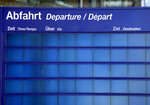 An empty information board is pictured at the main station in Berlin, Germany, Wednesday, Aug. 11, 2021. A nationwide, two-day train strike has brought big parts of the German railway and commuter system to a standstill. (AP Photo/Michael Sohn)