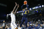 FILE - In this Jan. 29, 2020, file photo, Marquette's Markus Howard (0) shoots over Xavier's Naji Marshall (13) during the first half of an NCAA college basketball game in Cincinnati. Howard was selected to The Associated Press All-America first team, Friday, March 20, 2020. (AP Photo/John Minchillo, Fle)