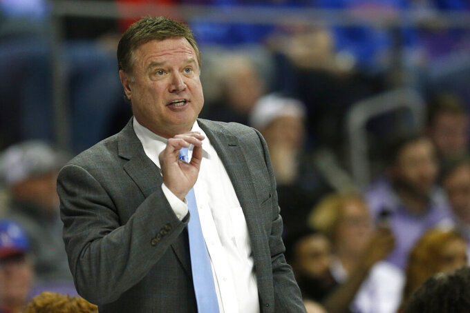 FILE - In this Feb. 8, 2020, file photo, Kansas head coach Bill Self reacts to a play as Kansas plays TCU during the second half of an NCAA college basketball game in Fort Worth, Texas. The outbreak of the coronavirus brought the sports world — the whole world, really — to a screeching halt, and that includes the crucial recruiting period for college coaches that were putting the finishing touches on their 2020 classes while laying the all-important groundwork for next year's classes. (AP Photo/Ron Jenkins, Fle)