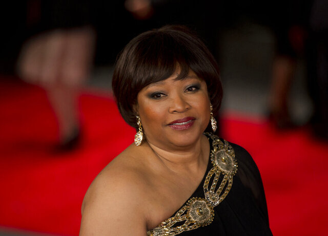 FILE — In this Dec. 5, 2013 file photo Zindzi Mandela, the daughter of the late Nelson Mandela poses for photographers as she arrives to attend the UK premiere of the movie