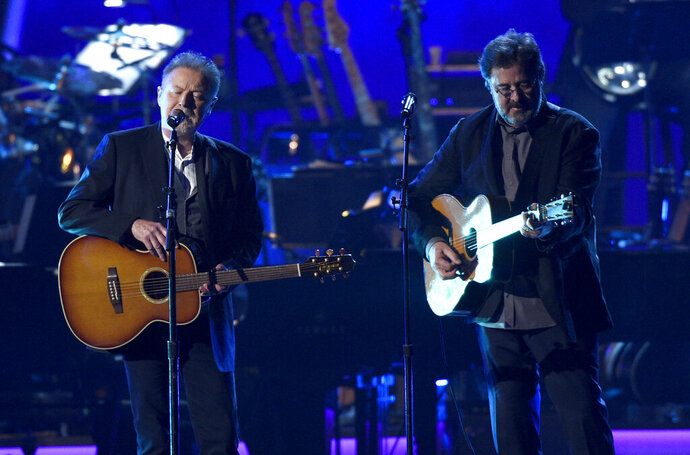 FILE - This Feb. 8, 2019 file photo shows Don Henley, left, and Vince Gill performing
