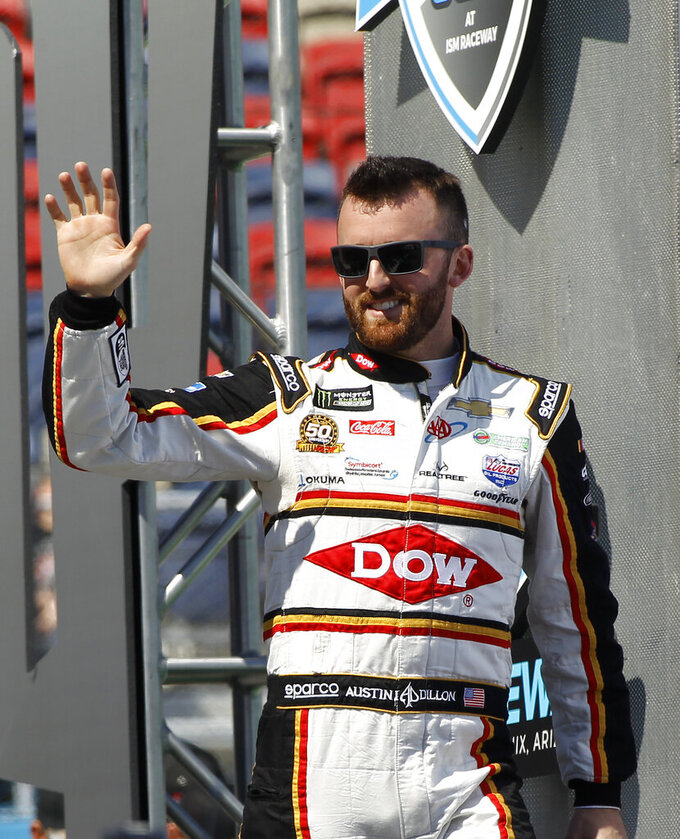 Austin Dillon waves to the crowd during driver introductions prior to the start of the NASCAR Cup Series auto race at ISM Raceway, Sunday, March 10, 2019, in Avondale, Ariz. (AP Photo/Ralph Freso)
