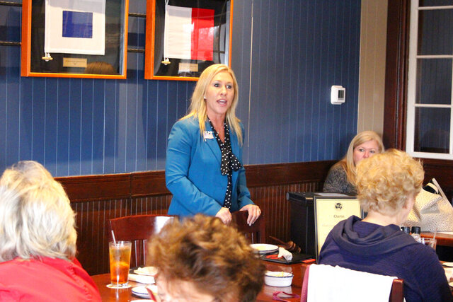 FILE- In this March 3, 2020 file photo, Republican Marjorie Taylor Greene speaks to a GOP women's group in Rome, Ga. Greene faces neurosurgeon John Cowan in a primary runoff election on Tuesday, Aug. 11 in northwest Georgia's 14th Congressional District. (John Bailey/The Rome News-Tribune via AP)