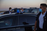 Israeli Prime Minister Benjamin Netanyahu wearing a face mask enters his car after attending a graduation ceremony for new pilots in Hatzerim air force base near the southern Israeli city of Beersheba, Israel, Thursday, June 25, 2020. (AP Photo/Ariel Schalit, Pool)