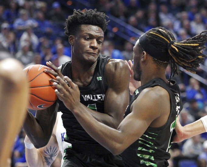 Utah Valley's Emmanuel Olojakpoke, left, pulls down a rebound near teammate Brandon Averette during the second half of an NCAA college basketball game in Lexington, Ky., Monday, Nov. 18, 2019. Kentucky won 82-74. (AP Photo/James Crisp)