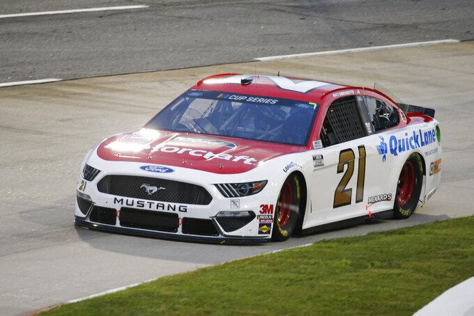 Matt DiBenedetto (21) drives during a NASCAR Cup Series auto race Wednesday, June 10, 2020, in Martinsville, Va. (AP Photo/Steve Helber)