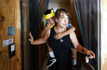 "Holly Sewell carries Byron Xol, an immigrant from Guatemala, during his birthday party Sunday, June 23, 2019, in Buda, Texas. ""I say, `Do you need a hug,' and the answer is always yes,"" Holly said. (AP Photo/David J. Phillip)"