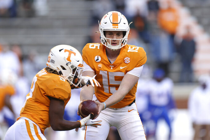 Tennessee quarterback Harrison Bailey (15) hands the ball off to running back Eric Gray (3) during the first half  of the team's NCAA college football game against Florida on Saturday, Dec. 5, 2020, in Knoxville, Tenn. (Randy Sartin/Knoxville News Sentinel via AP, Pool)