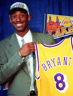 FILE - In this July 12, 1996, file photo Kobe Bryant, 17, jokes with the media as he holds his Los Angeles Lakers jersey during a news conference at the Great Western Forum in Inglewood, Calif. Bryant, a five-time NBA champion and a two-time Olympic gold medalist, died in a helicopter crash in California on Sunday, Jan. 26, 2020. (AP Photo/Susan Sterner, File)