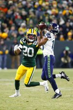 Seattle Seahawks' Tyler Lockett catcxhes a pass in front of Green Bay Packers' Kevin King during the second half of an NFL divisional playoff football game Sunday, Jan. 12, 2020, in Green Bay, Wis. (AP Photo/Matt Ludtke)