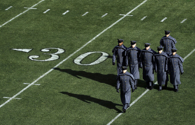 Army cadets march onto the field before an NCAA college football game against Navy, Saturday, Dec. 8, 2018, in Philadelphia. (AP Photo/Matt Slocum)