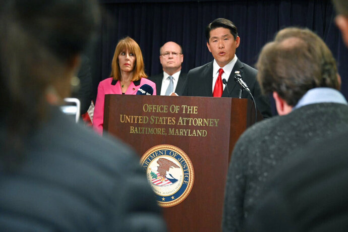 U.S. Attorney Robert K. Hur, center, speaks at a press conference announcing the indictment of former Baltimore Mayor Catherine Pugh, Wednesday, Nov. 20, 2019, in Baltimore. Pugh was charged Wednesday with fraud and tax evasion involving sales of her self-published children's books. (Lloyd Fox/The Baltimore Sun via AP)