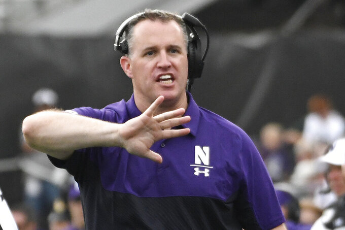 Northwestern head coach Pat Fitzgerald gestures to the officials during the second half of an NCAA college football game against Michigan State, Saturday, Sept. 21, 2019, in Evanston, Ill. (AP Photo/David Banks)