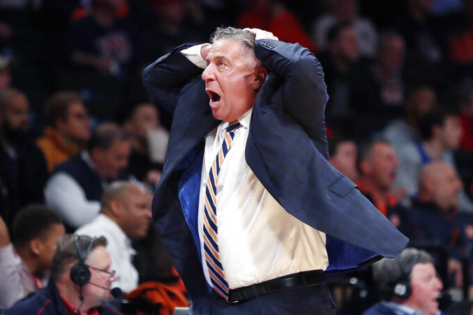 Auburn head coach Bruce Pearl reacts to an official's call in the first half of an NCAA college basketball game against Richmond in the Legends Classic, Tuesday, Nov. 26, 2019, in New York. (AP Photo/Kathy Willens)