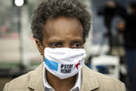 Chicago Mayor Lori Lightfoot wears a face mask as she tours a new coronavirus drive-thru testing site at Dr. Jorge Prieto Math and Science Academy, 2231 N. Central Ave., organized by the CORE disaster relief organization started by actor Sean Penn, Monday morning, May 18, 2020.  (Ashlee Rezin Garcia/Chicago Sun-Times via AP)