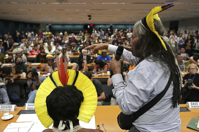 Kayapo leader Raoni Metuktire speaks during a meeting with lawmakers to discuss land rights and the Chamber of Deputies' role in the protection of the environment in Brasilia, Brazil, Thursday, April 25, 2019. Discussions held in congressional chambers Thursday were occurring on the sidelines of an annual three-day protest known as the Free Land Encampment in Brasilia. (AP Photo/Eraldo Peres)