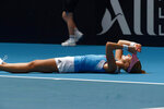 France's Kristina Mladenovic lies on the court after winning her match against Australia's Ash Barty during their Fed Cup tennis final in Perth, Australia, Sunday, Nov. 10, 2019. (AP Photo/Trevor Collens)