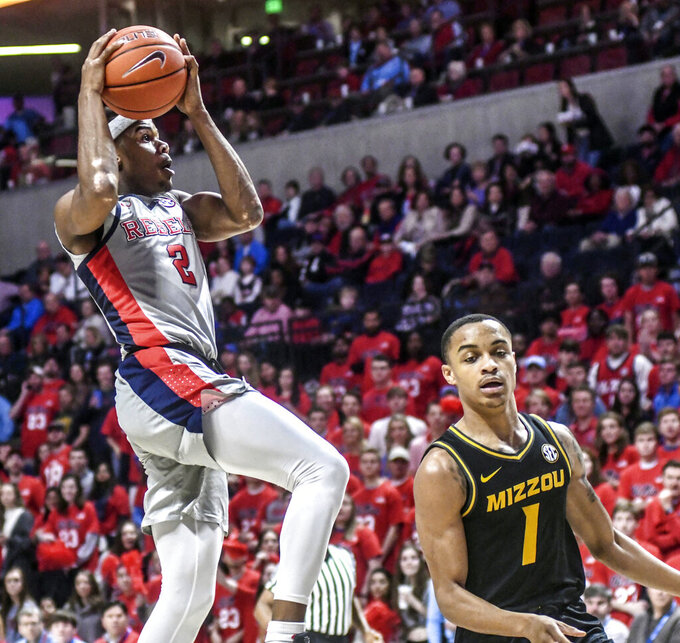 Mississippi guard Devontae Shuler (2) scores against Missouri's Xavier Pinson (1) during an NCAA college basketball game in Oxford, Miss., Saturday, Feb. 16, 2019. (Bruce Newman/The Oxford Eagle via AP)