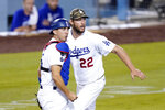 Los Angeles Dodgers catcher Austin Barnes, left, watches his throw to first along with starting pitcher Clayton Kershaw to get Miami Marlins' Adam Duvall out during the fifth inning of a baseball game Friday, May 14, 2021, in Los Angeles. (AP Photo/Mark J. Terrill)