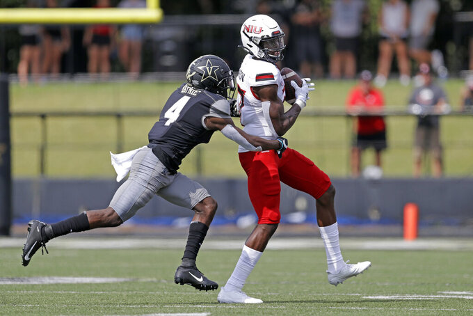 Northern Illinois wide receiver Dennis Robinson (17) catches a pass as he is defended by Vanderbilt defensive back Randall Haynie (4) in the second half of an NCAA college football game Saturday, Sept. 28, 2019, in Nashville, Tenn. Vanderbilt won 24-18. (AP Photo/Mark Humphrey)