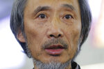 Chinese dissident writer Ma Jian speaks to media after arriving Hong Kong international airport, Friday, Nov. 9, 2018. Hong Kong on Friday permitted dissident writer Ma to enter to attend a literary festival, even after an arts venue in the city canceled his appearance. Ma, whose novels frequently satirize China's communist leaders, told reporters he experienced nothing unusual while passing through passport control and that organizers were still lining-up a place for him to speak.